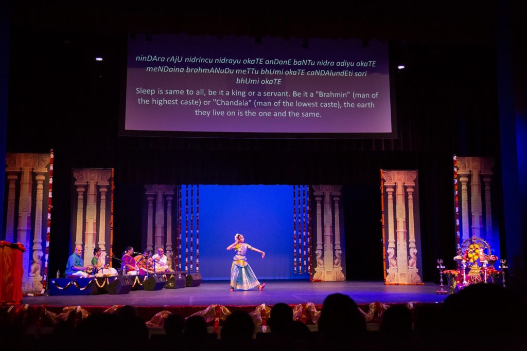 As Nikita performed, the lyrics and English translation were projected above her.